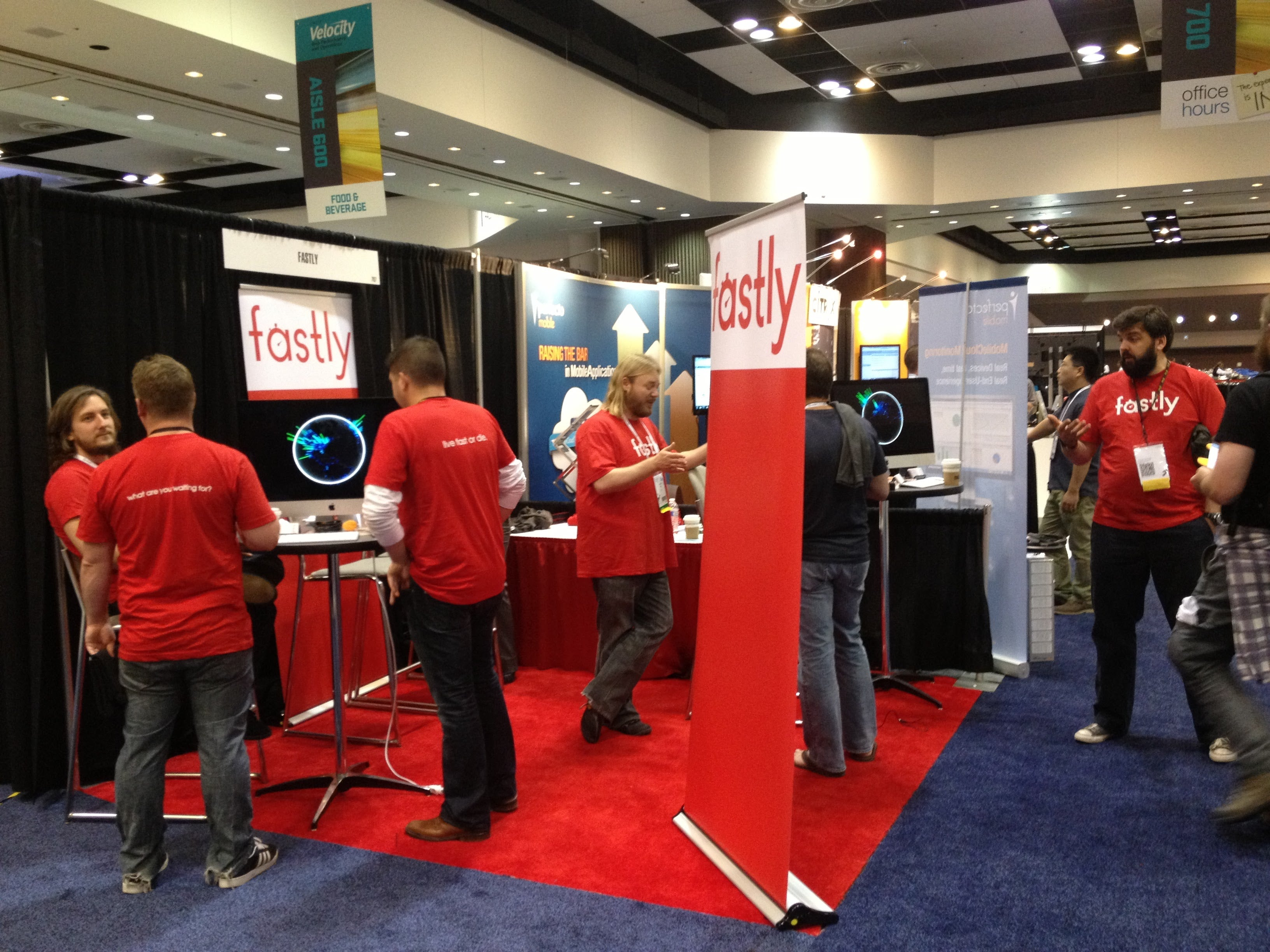 The Fastly team staffs a booth at Velocity conference.